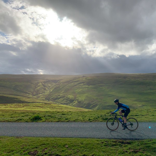 Cyclist nearing the top of Park Rash, Yorkshire Dales