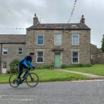 Cycling through Askrigg, Yorkshire Dales