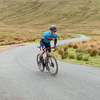 Cyclist cycling Tan Hill on the Etape du Dales route