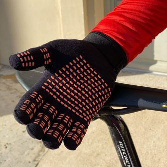 stolen goat gloves with orange grippers on underside