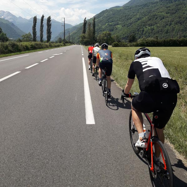 Road cyclists on famous Raid Pyrenees route, France