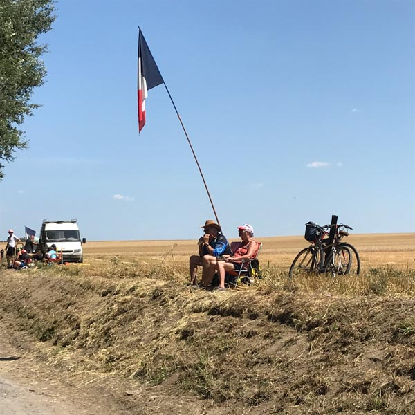 Spectators watching the Tour de France in person