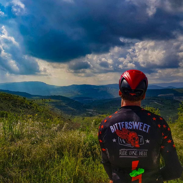 Road cyclist admiring Cyprus landscapes