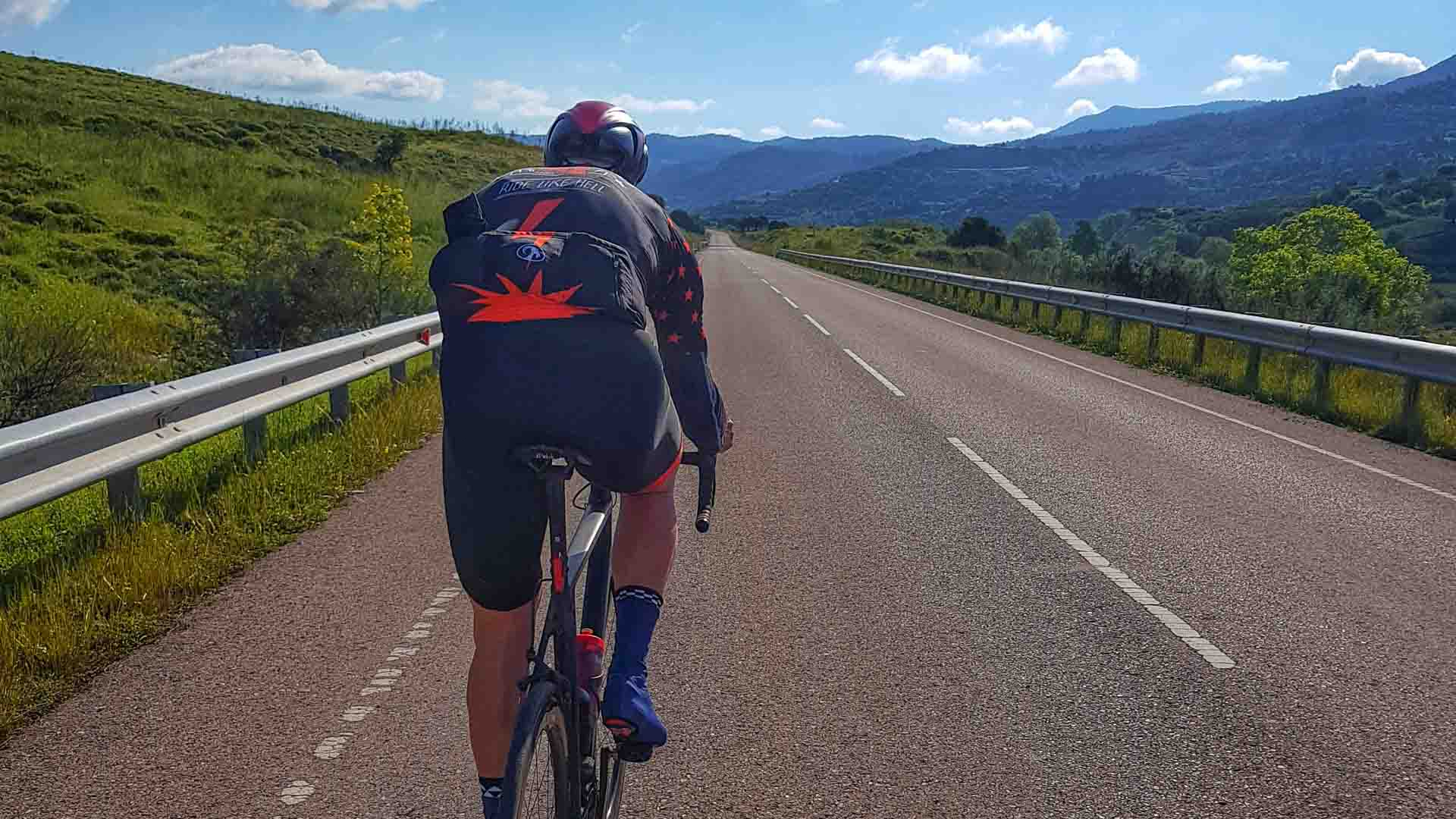 Road cyclist climbing Mount Olympus by road bike