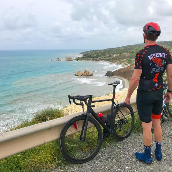 Cyclist looking at Aphrodite's Rock
