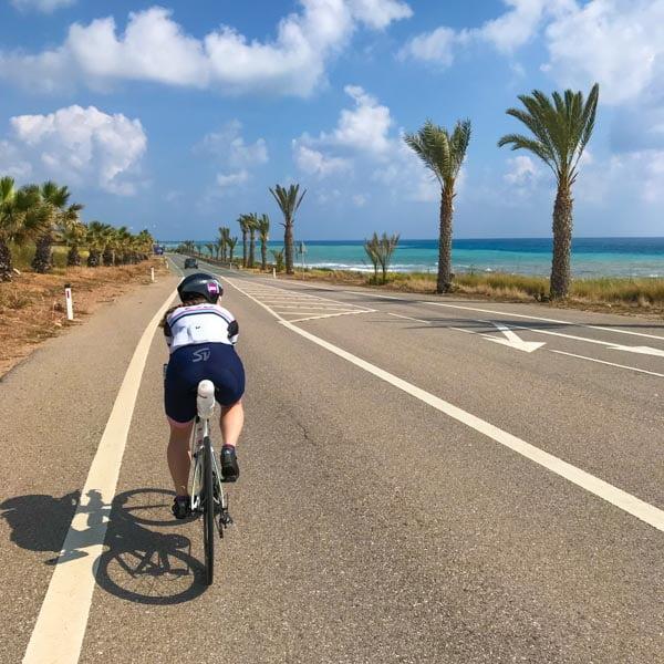 Cyclist riding to Pissouri Bay, Cyprus