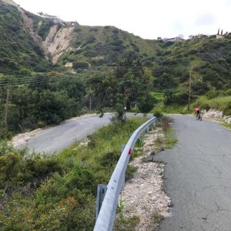 Switchback and road cyclist in Cyprus