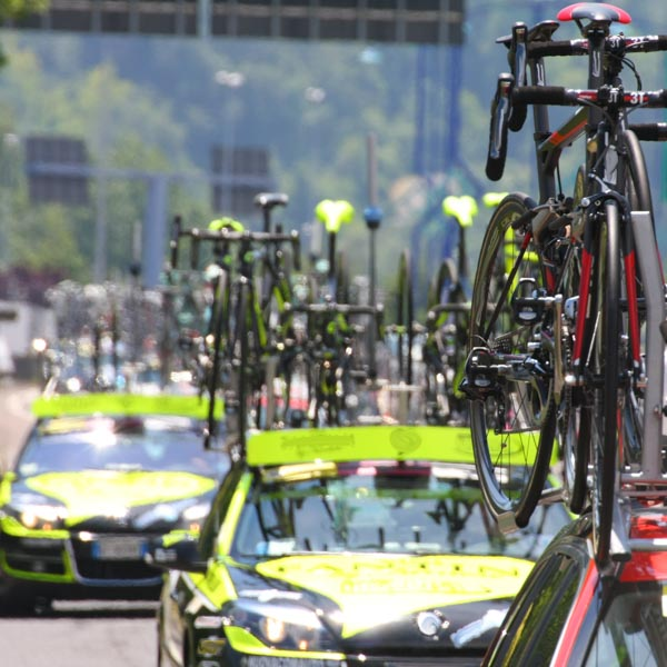 Bikes on the roofs of tour de france cycling team cars