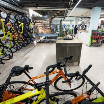 Inside Bike Breaks Girona shop showing bike rental available