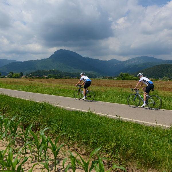 Cyclists cycling through Olot, near Girona, a wonderful cycling holiday in Europe