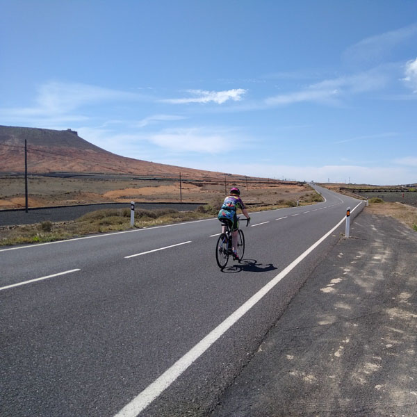 Cyclist descending LZ-10 just before Teguise, Lanzarote