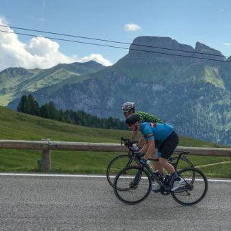 Two cyclists on the Passo Pordoi, Italian Dolomites