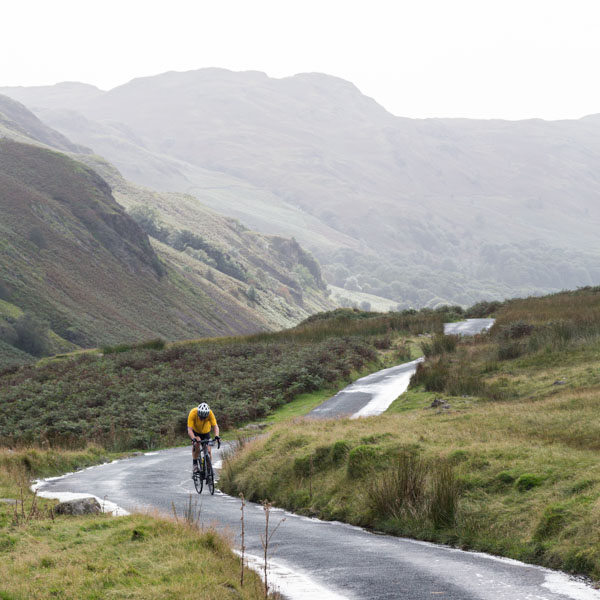 Cyclist on the Hardknott Pass, Lake District