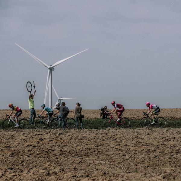 Cyclists cycling through rural terrain