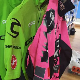 Pro team cycling jerseys in green and pink