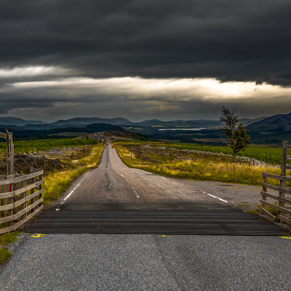 Looing clouds over a Scottish country road