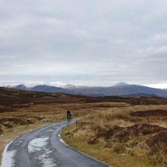 Cyclist on Glen Quaich, Scotland