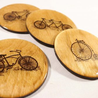 Wooden coasters with bikes on them cycling gift