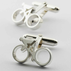 Silver cufflinks with cyclist and bicycle