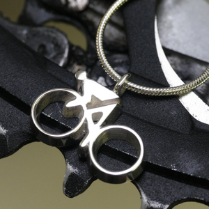 Silver cyclist pendant necklace
