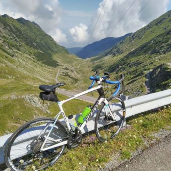 Bike overlooking Transfagarasan highway switchbacks
