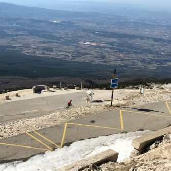 View from Mont Ventoux of a cyclist climbing Mont Ventoux