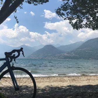 Cycling Lake Como with bike on beach at Lake Como