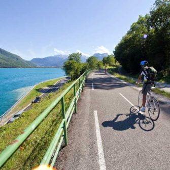 Cyclist cycling around Lake Geneva