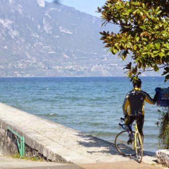 Cyclist admiring Lake Geneva Switzerland