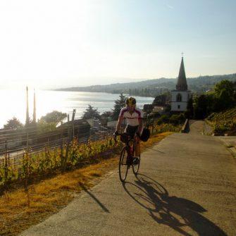 Cyclist cycling around Geneva and its lake