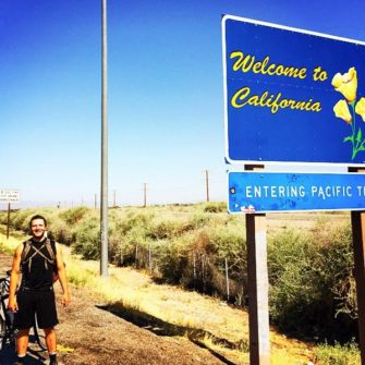 At the end of cycle trip across America coming into California