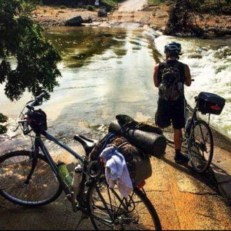 Cyclists preparing to cross a river while biking across America