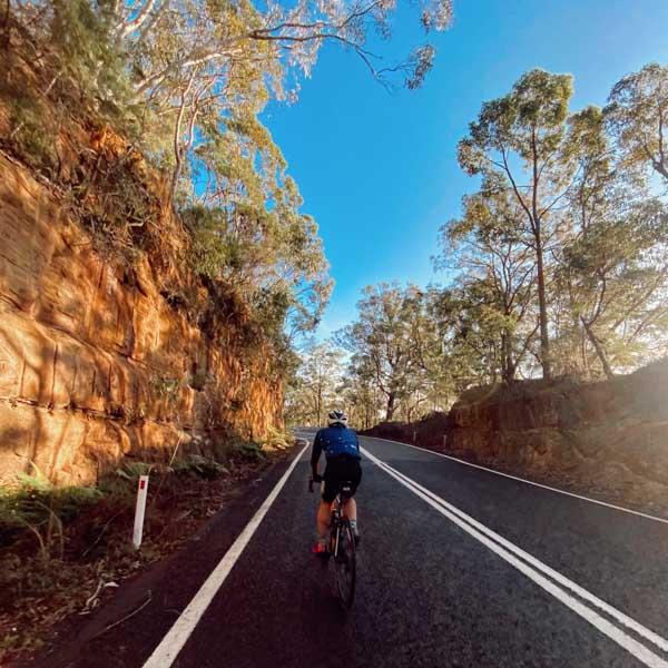 Cycling up Mount White near Sydney Australia
