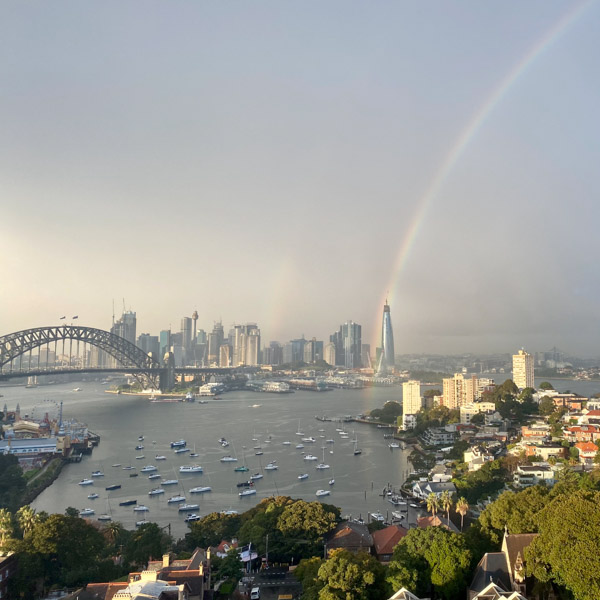 View over Sydney harbour with rainbow