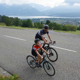 Cyclists above Lake Annecy, French Alps