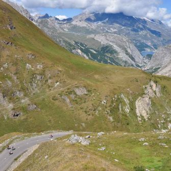 Summer in the Alps with road in foreground