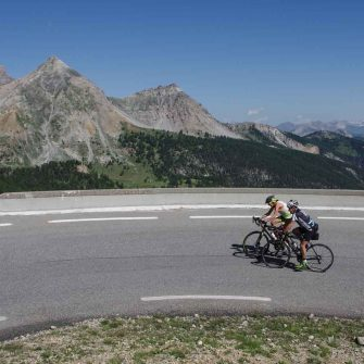 Two road cyclists on the Route des Grandes Alpes