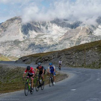 Four cyclists on a pass of the Route des Grandes Alpes in France