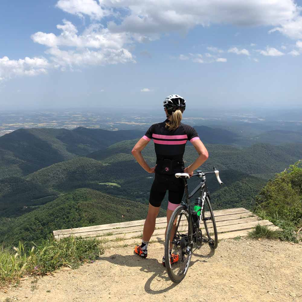 Cycling completing cycling challenge in Girona