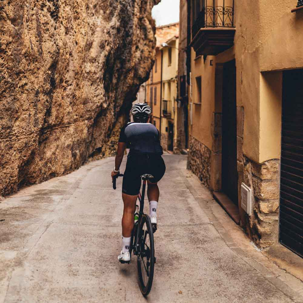 Cyclist in a traditional village costa daurada spain