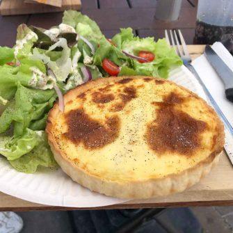 Cheese tart and salad by lake geneva