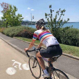 Cyclist at Thonon Les Bains by lake geneva