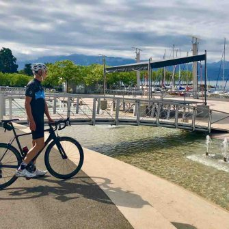 Cyclist by Lake Geneva, Switzerland