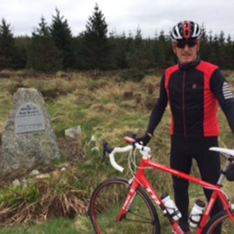 Cyclist at the Shay Elliott (cyclist) Memorial in Wicklow Mountains, Ireland