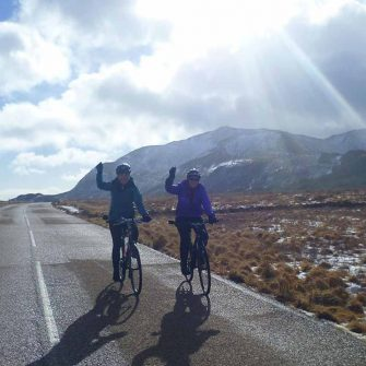 Two cyclists cycling in Arran in Winter