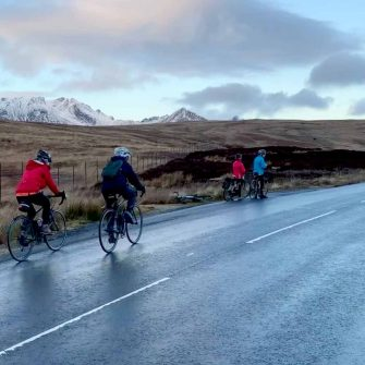 Cyclists in winter on The String, Arran, Scotland