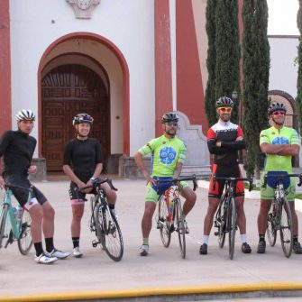 Cyclists in front of a church