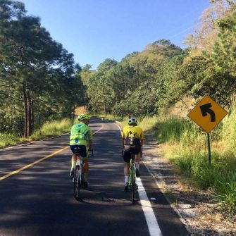 Road cyclists climbing the Sierra Madre mexico