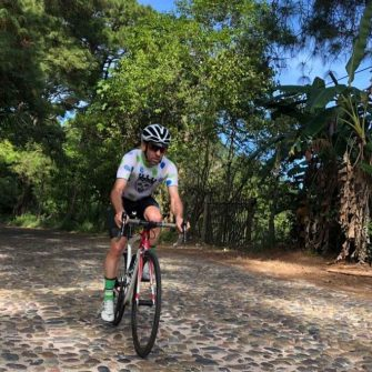 Cyclist on cobblestones near San Sebastian