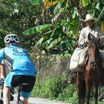 Cyclist and horse El Tuito, Mexico